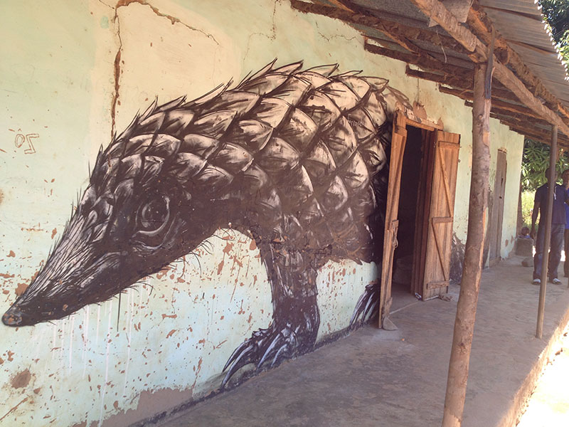 Aardvark painted on the side of a home